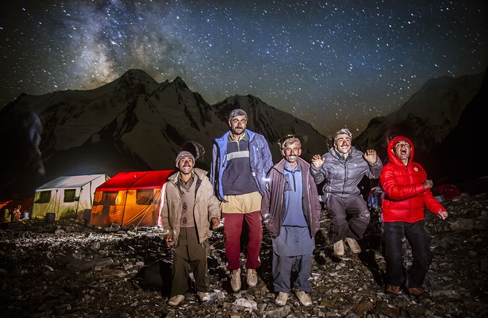 10. The porters photographed outside at base camp. They sometimes light fires using rubbish from the expeditions